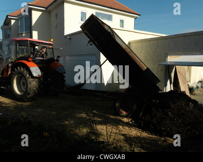tractor Delivering horse Manure For Garden cheam Surrey England - Stock Photo