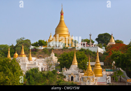 The exterior of a Buddhist Monastery is located at the base of SAGAING HILL near MANDALAY - MYANMAR - Stock Photo