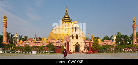 The exterior of the THIDAGU WORLD BUDDHIST UNIVERSITY is located at the base of SAGAING HILL near MANDALAY - MYANMAR - Stock Photo
