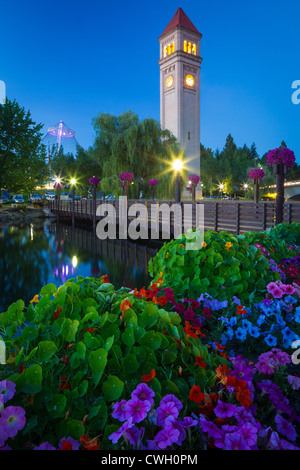 The Spokane clock tower in Riverfront Park in Spokane, Washington at night - Stock Photo