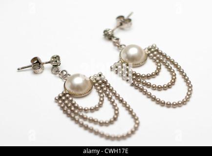 Pair of vintage chandelier pearl dangle earrings - Stock Photo