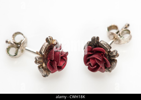 Pair of small red rose stud earrings Stock Photo