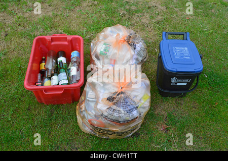 Domestic refuse collection bins & recycle sacks placed on verge awaiting collection by local authority (food waste - Stock Photo