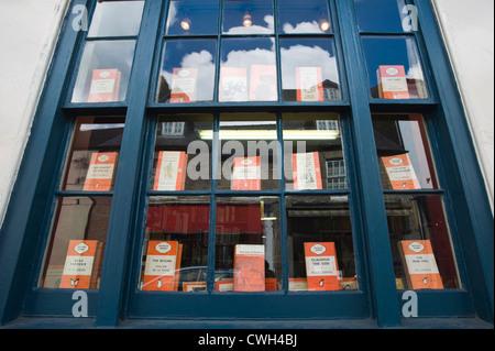 Penguin books display in window of bookshop in Hay on Wye, Powys, Wales, Cymru, UK - Stock Photo