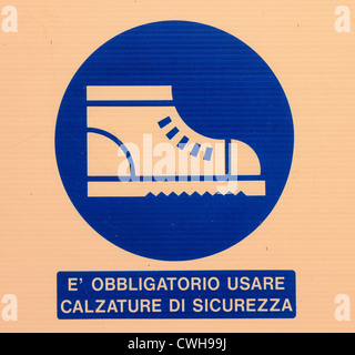 Italian health and safety sign notice at work building site - Stock Photo