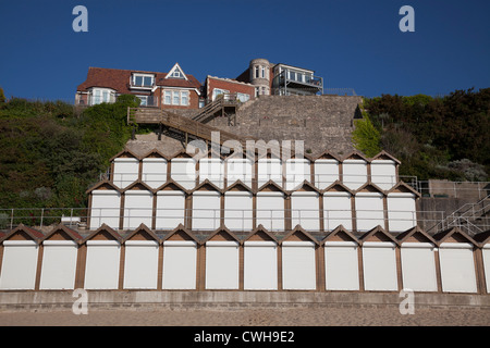 Stack of three tiers of white doored beach huts at Swanage. - Stock Photo