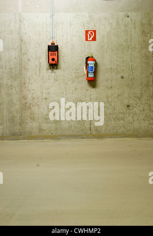 concrete,sos,fire extinguisher - Stock Photo