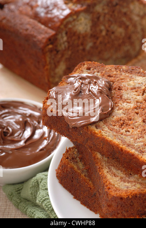 Freshly baked banana and chocolate nut bread with Nutells - Stock Photo