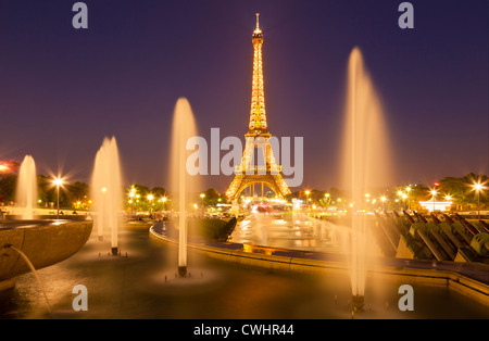 Paris skyline France EU Europe Eiffel tower with Trocadero fountains at night - Stock Photo
