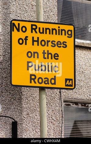 AA Street sign prohibiting the running of horses on the public road - Stock Photo