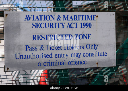 Sign warning against unauthorised entry under the Aviation and maritime security act 1990 - Stock Photo