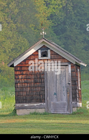 An old farm building in worn condition. - Stock Photo