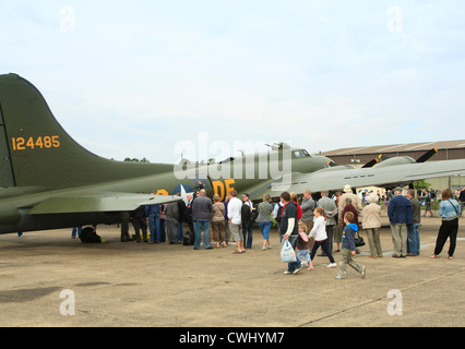 Queue of aeroplane enthusiasts waiting to look aboard the Flying Fortress SAlly B at Duxford airshow - Stock Photo