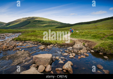 Hikers walking through the Cuillin mountains near Glenbrittle on the Isle of Skye in Scotland, UK - Stock Photo
