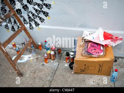 Graffiti stencils and spray cans - Stock Photo