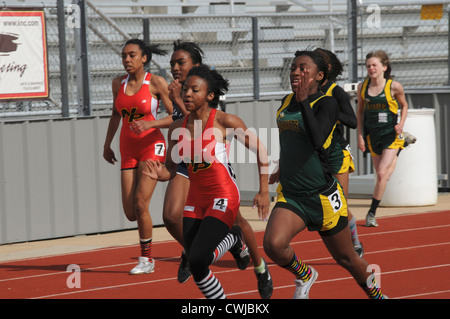 Girl's high school track meet - Stock Photo