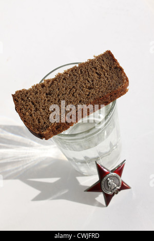Order 'Great Patriotic War' and glass. The custom of 'wash' Order and rip. - Stock Photo