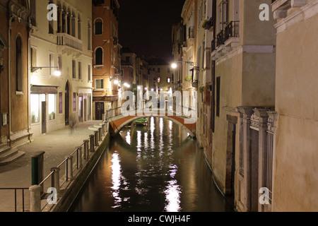 Italy. Night Venice. Bridge over the canal - Stock Photo
