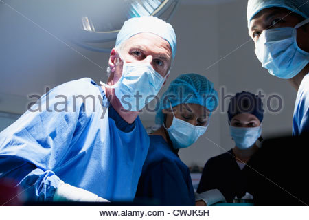 Portrait of surgeons working in operating room - Stock Photo