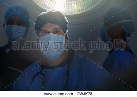 Portrait of confident surgeons in operating room - Stock Photo