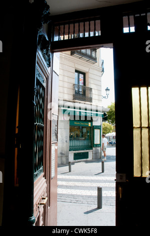 View from an open door, Santa Ana square. Madrid, Spain.
