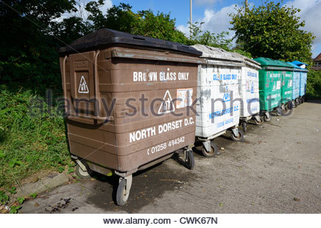 Glass recycling bins, Blandford Forum, Dorset England - Stock Photo
