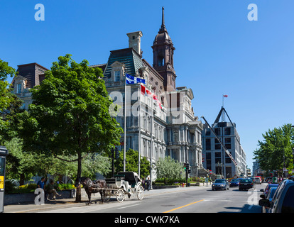 City Hall (Hotel de Ville) on Rue Notre-Dame, Vieux Montreal, Quebec, Canada - Stock Photo