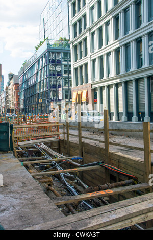 Con Edison and the City of New York installing a new infrastructure below Grand Street in Downtown Manhattan - Stock Photo