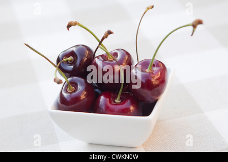 some fresh cherries on a table - Stock Photo