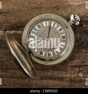 antique pocket watch on a wooden background - Stock Photo
