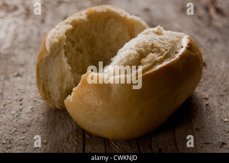 bread on a wooden plate - Stock Photo