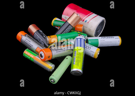 Group of different size batteries isolated on black background - Stock Photo