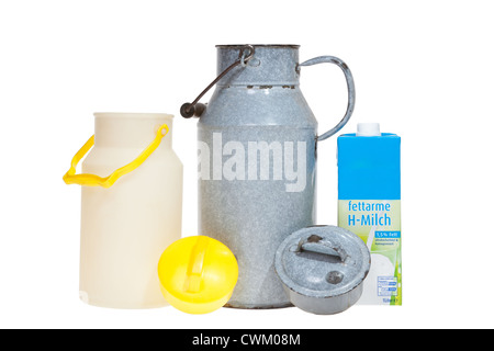 Three generations of milk cans and milk cartons isolated on white background - Stock Photo
