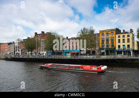 Tourist boat on the Liffey river, Dublin, Republic of Ireland. - Stock Photo
