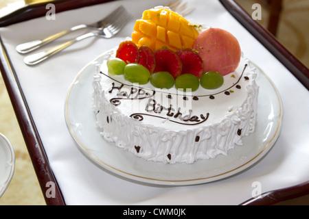 Happy Birthday Fresh Fruit Cake Isolated on White Background Stock