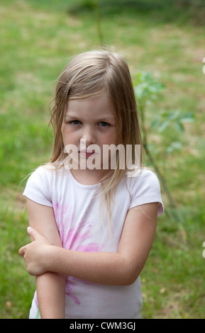 Outdoor portrait of a solum young French girl age 8. Zawady Central Poland - Stock Photo