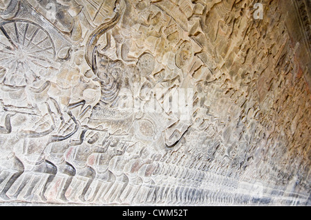 Horizontal close up view of the amazing bas-relief carvings covering the walls at Prasat Angkor Wat - Stock Photo