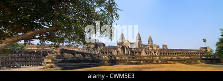 Horizontal panoramic (2 picture stitch) view of the East entrance to the main temple at Angkor Wat - Stock Photo