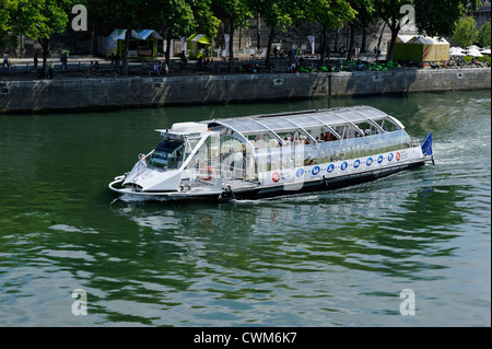 Tourist sight seeing boat cruising on the River Seine in PAris, France - Stock Photo