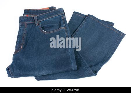 Folded blue jean on white black ground - Stock Photo