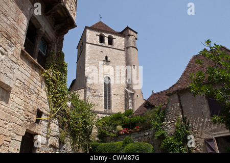 Looking up at the medieval church overlooking the beautiful village of Saint-Cirq-Lapopie in Lot region of South - Stock Photo