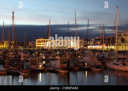 Yachts in the marina of Lagos at dusk. Algarve Portugal - Stock Photo