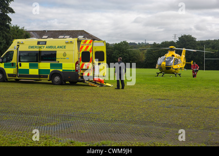 An Aircraft of the North West Air Ambulance rendezvous with an Ambulance - Stock Photo
