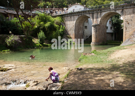 People swim in the river in the village of Vers, France. - Stock Photo