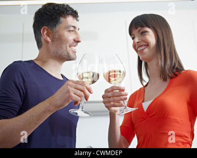 Germany, Cologne, Man and woman drinking wine - Stock Photo
