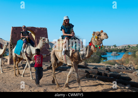 Women tourists in Gharb Soheil Nubian Village on the west bank of the River Nile next to Aswan Egypt - Stock Photo