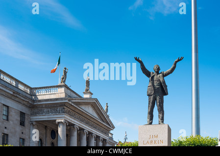 Jim Larkin statue with General Post Office and Spire on O'Connell Street by sculpture Oisín Kelly Dublin Republic - Stock Photo