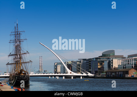 Jeanie Johnston Tall Ship & Famine Museum, 1 Custom House Quay, with Samuel Beckett Bridge on River Liffey, Dublin, - Stock Photo