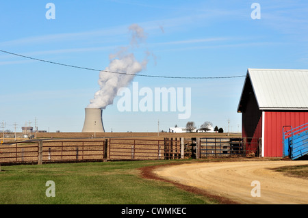 Nuclear Power twin cooling towers of the Byron Nuclear Power Plant amid agricultural land potentially dangerous - Stock Photo