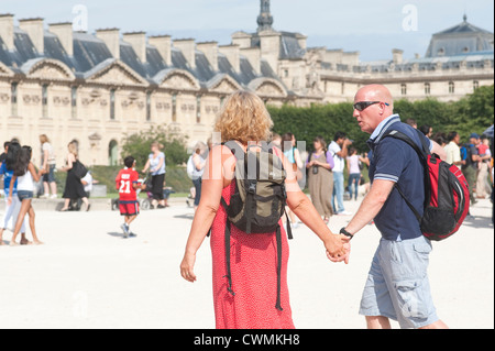 Paris, France - July  2012 -  Adult couple visiting around the Louvre Museum area. - Stock Photo
